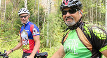 Cyclist Tom Baltes (right) with fellow rider Eric Uhlberg during trek across the United States to raise awareness about arthritis. Photo: Camas-Washougal Post-Record